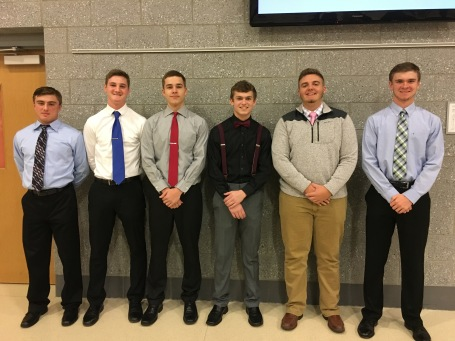 A group of junior boys all get together for a nice picture at the NHS induction last night.