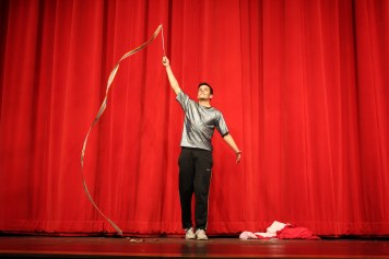 Sam Hanna performs a ribbon dance for the crowd. Photo by Emily Thompson