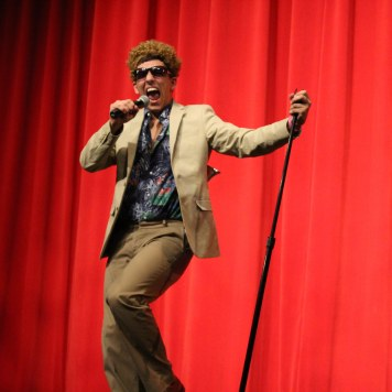 Vinnie Lobello lip sings for the talent portion of Mr.WHS. Photo by Emily Thompson